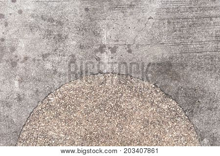 Rough concrete texture with pebbles decor. Grey asphalt road top view photo. Distressed and obsolete background texture. Gray concrete floor top view. Rustic asphalt road surface. Grungy grit backdrop