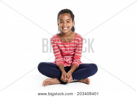 An Adorable african little girl on studio white background
