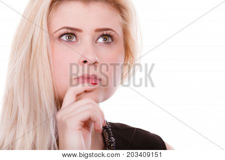 Closeup portrait of thinking blonde woman making serious neutral face contemplating about things and ideas.