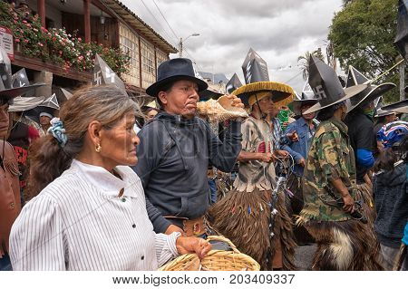July 24 2017 Cotacachi Ecuador: man blows a seashell horn during Inti Raymi parade