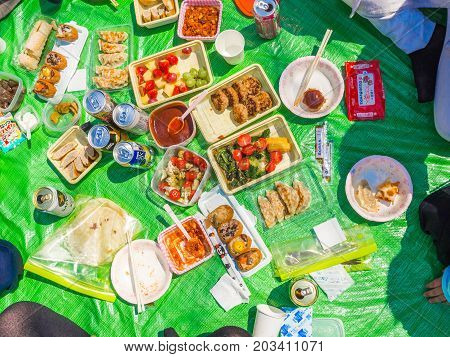 HAKONE, JAPAN - JULY 02, 2017: Assorted food for lunch in a park in hanami park during cherry blossom season in Kyoto, Japan.