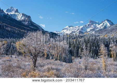 Redcliff Peak and Coxcomb Peak viewed from Cimarron River Valley after early fall snow storm.