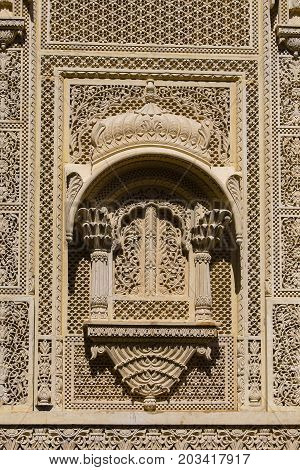 Indian ornament on wall of palace in Jaisalmer fort India.