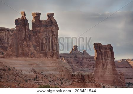 The Courthouse Towers is a collection of tall stone columns located in Arches National Park.