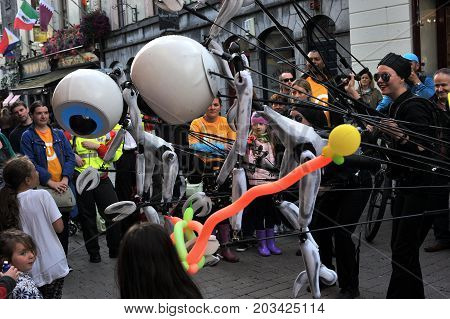 Shop Street, Galway, Ireland July , Art Festival 2017, I-puppets , I Puppets Playing With Kids