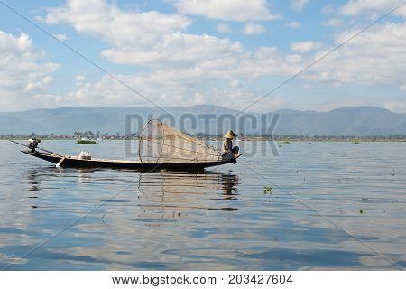 A resting fisherman on the Inle Lake. Burma