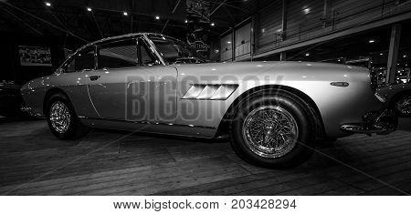 MAASTRICHT NETHERLANDS - JANUARY 08 2015: The sports car Ferrari 330 GT 2+2 Series II. Black and white. International Exhibition InterClassics & Topmobiel 2015