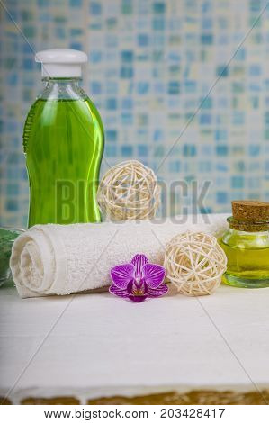 Spa treatments in the bathroom. Sea salt soap and orchid close-up.