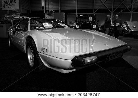 MAASTRICHT NETHERLANDS - JANUARY 08 2015: The sports car Ferrari 308 GTB. Black and white. International Exhibition InterClassics & Topmobiel 2015