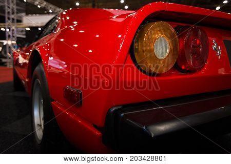 MAASTRICHT NETHERLANDS - JANUARY 08 2015: The rear brake lights of a sports car Ferrari 308 GTB. International Exhibition InterClassics & Topmobiel 2015