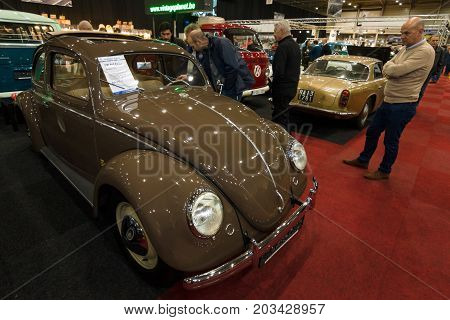 MAASTRICHT NETHERLANDS - JANUARY 08 2015: Economy car Volkswagen Beetle 1951. International Exhibition InterClassics & Topmobiel 2015