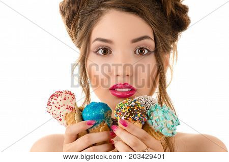 beautiful woman with expressive eyes and makeup with ice cream in hands