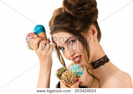 charming brunette with bright makeup on lips and with ice cream in hands