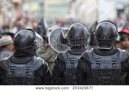 June 24 2017 Cotacachi Ecuador: police force on guard during Inti Raymi celebration which occasionally ends up with violence