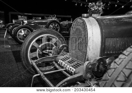 MAASTRICHT NETHERLANDS - JANUARY 08 2015: Racing Cars Bugatti Type 35/37/54 standing in a row. Black and white. International Exhibition InterClassics & Topmobiel 2015