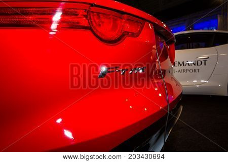 MAASTRICHT NETHERLANDS - JANUARY 08 2015: The rear brake lights of a roadster Jaguar F-Type. International Exhibition InterClassics & Topmobiel 2015