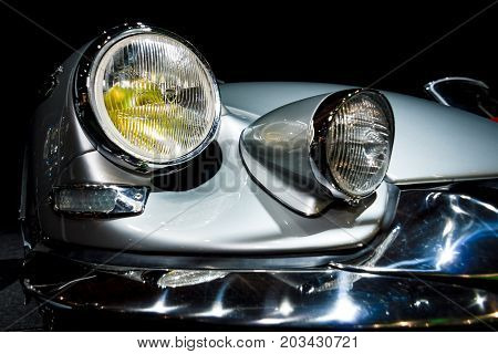 MAASTRICHT NETHERLANDS - JANUARY 08 2015: Headlamp Citroen DS19 Chapron Concorde 64. Toning. Stylization. International Exhibition InterClassics & Topmobiel 2015