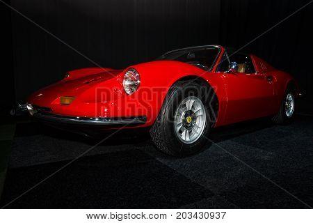 MAASTRICHT NETHERLANDS - JANUARY 08 2015: Sports car Ferrari Dino 246 GT. International Exhibition InterClassics & Topmobiel 2015