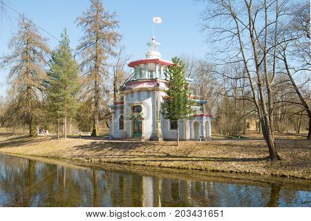 View of the old Creaking (Chinese) arbor in the sunny May afternoon. Tsarskoye Selo, Russia