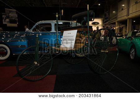 MAASTRICHT NETHERLANDS - JANUARY 08 2015: The first car Benz Patent-Motorwagen (motorcar) built in 1886. International Exhibition InterClassics & Topmobiel 2015