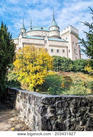 Bojnice castle in Slovak republic. Yellow autumn trees. Cultural heritage. Seasonal scene. Vibrant colors.