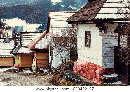 Beautiful wooden houses in Vlkolinec village Slovak republic Unesco. Cultural heritage. Travel destination. Old photo filter.