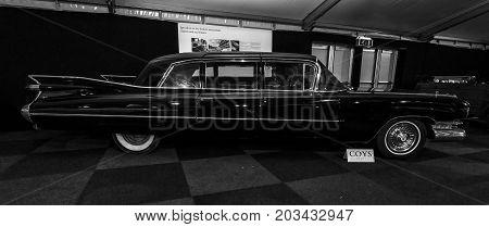 MAASTRICHT NETHERLANDS - JANUARY 08 2015: Full-size luxury car Cadillac Series 75 Fleetwood 6700 Limousine 1959. Black and white. International Exhibition InterClassics & Topmobiel 2015