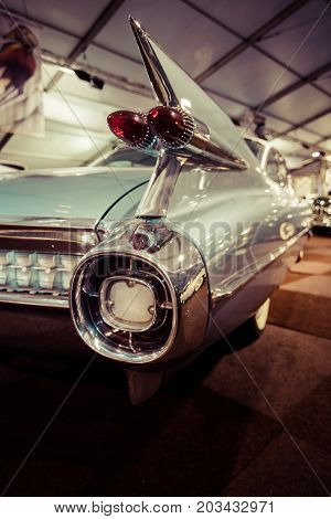 MAASTRICHT NETHERLANDS - JANUARY 08 2015: The rear brake lights a full-size luxury car Cadillac Sixty Special Fleetwood 1968. Stylization. Vintage toning. International Exhibition InterClassics & Topmobiel 2015