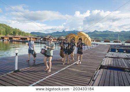September 04, 2017 : Tourists  Walking On Wooden Raft In The Resort At Srinakarin Dam, Kanchanaburi,