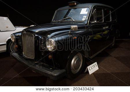MAASTRICHT NETHERLANDS - JANUARY 08 2015: London taxi cab LTI FX4 (Austin FX4). International Exhibition InterClassics & Topmobiel 2015