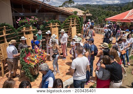 August 6 2017 Medellin Colombia: tourists visiting a farm during the flower festival in the Piedra Gorda area