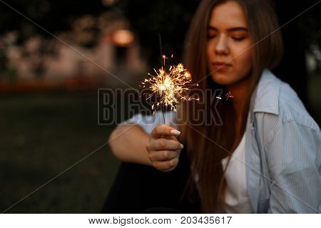 Close-up Picture Of Bright Bengal Fire In Women's Hands, The Concept Of The Holiday