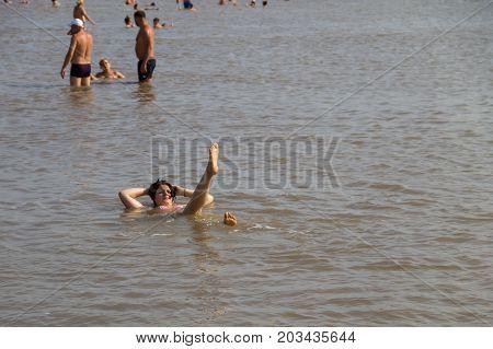 Unknown People Bathe In The Salt Lake
