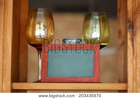 Two Wine Glasses On Wooden Shelf With Frame