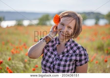 Smiling Woman With Poppy Flower In Her Hair