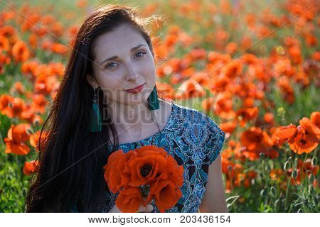 Portrait Of Woman With Bunch Of Poppies