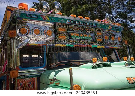 August 6 2017 Medellin Colombia: colourful old buses called 'chiva' used as prty buses during the flower festival