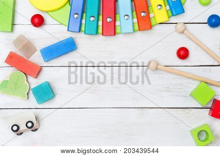 Wooden educational toys on a wooden background