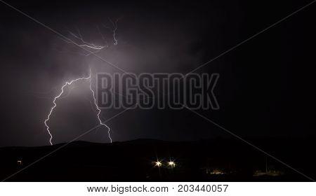 Long shot view of Lightning strike over mountain range