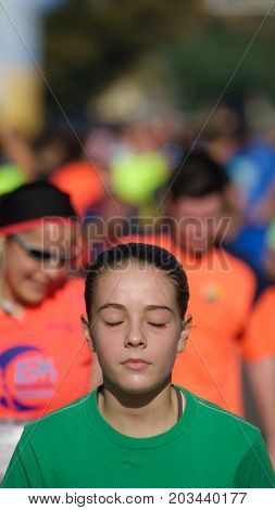 VALENCIA - NOVEMBER 13: Unidentified woman arrives to finish line with closed eyes in the I edition of race against gender violence on November 13, 2016 in Valencia, Spain
