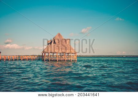 Pier With Clouds And Blue Water At The Laguna Bacalar, Chetumal, Quintana Roo, Mexico.