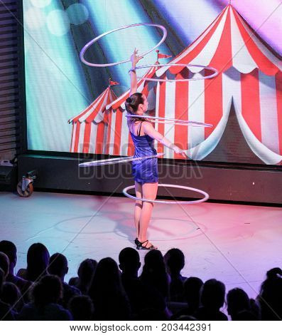 Yalta, Crimea - 11 July, Soloist with hoops on stage, 11 July, 2017. Performance of young artists on the stage of the hotel Yalta Intourist .