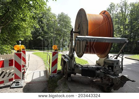 big cable drum near the street with broadband cable