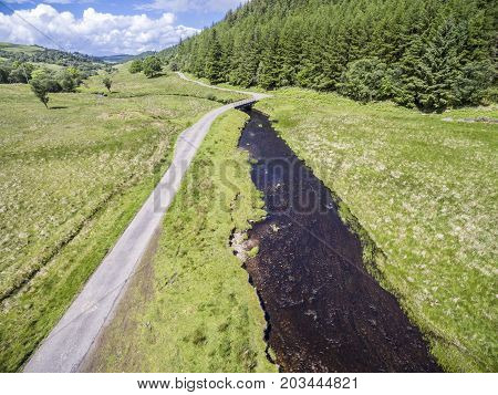 Aerial view of the street between Oban and Taynuilt next to the river Nell, Argyll, Scotland