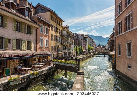 Annecy France - May 25 2016: View of the Thiou river flowing through the city of Annecy capital of Haute Savoie province in France. Annecy is known to be called the French Venice.