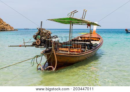 Long Boat With Engine And Tropical Beach