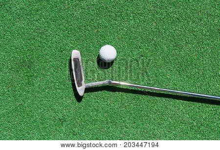 Mini-golf ball on artificial grass. Summer season game