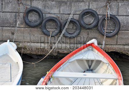 boat near the stone wall close up photo