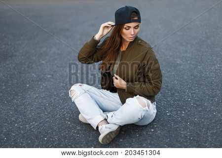 Beautiful Young Woman With Freckles In A Black Baseball Cap In A Fashionable Military Green Jacket A