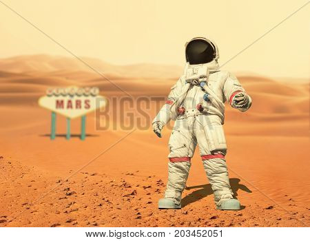 Spaceman Walks On The Red Planet Mars. Space Mission. Welcome To Mars Sign. Astronaut Travel In Spac